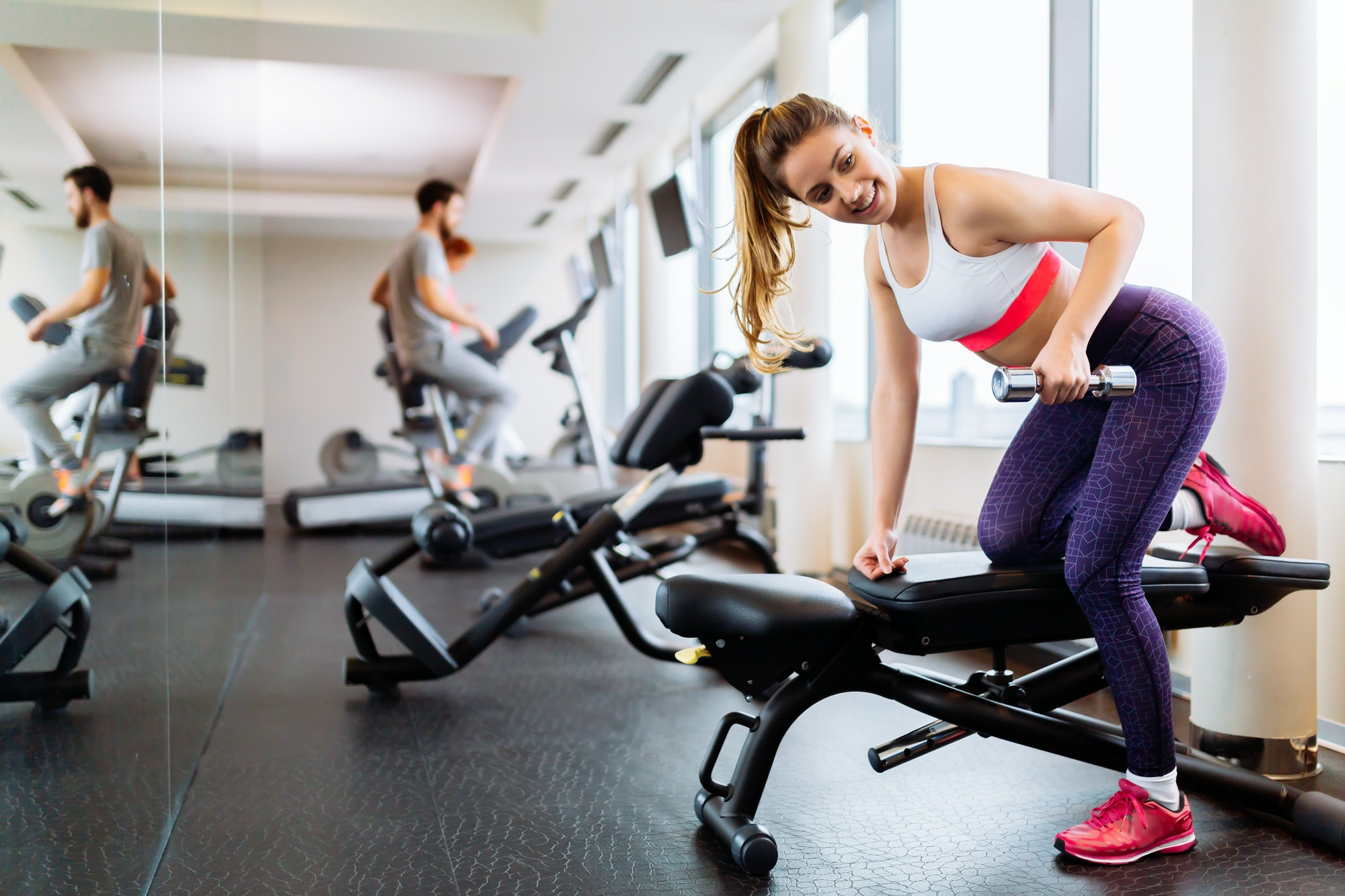 fit-woman-working-out-in-gym.jpg